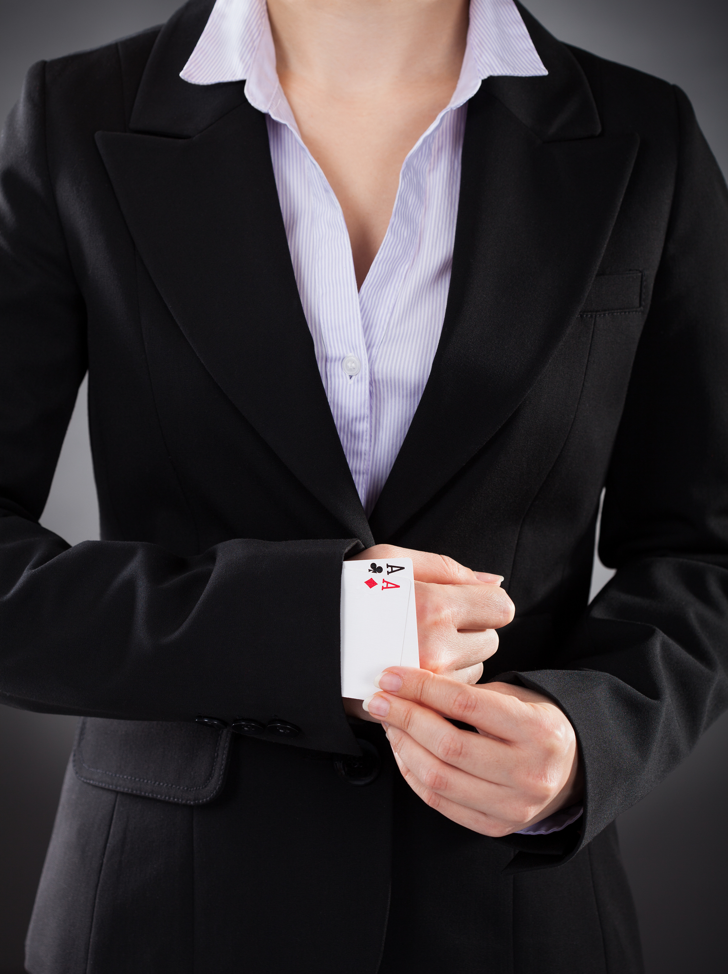 Business Woman with ace up sleeve